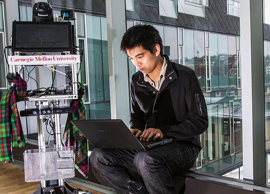 Richard Hang a graduate student with a robot   at Carnigie Mellon University